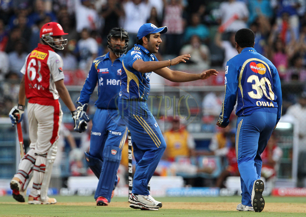 Mumbai Indian players celebrates after a wicket during match 28 of the Indian Premier League ( IPL) 2012  between The Mumbai Indians and the Kings X1 Punjab held at the Wankhede Stadium in Mumbai on the 22nd April 2012..Photo by: Vipin Pawar/IPL/SPORTZPICS