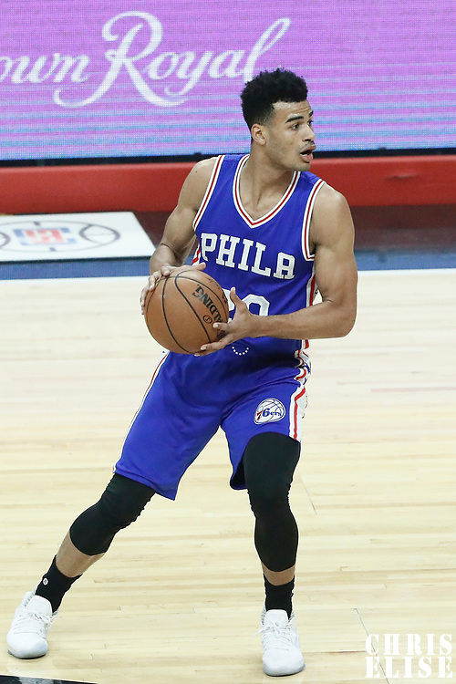 11 March 2017: Philadelphia 76ers guard Timothe Luwawu-Cabarrot (20) looks to pass the ball during the LA Clippers 112-100 victory over the Philadelphia Sixers, at the Staples Center, Los Angeles, California, USA.