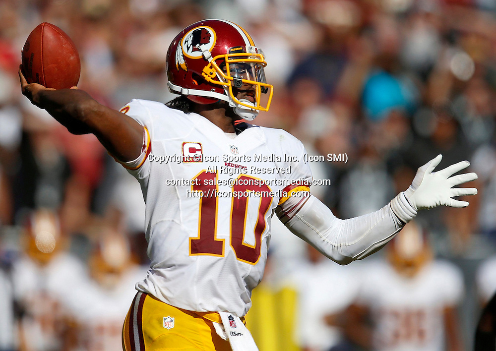 September 29, 2013 - Oakland, CA, USA - Washington Redskins starting quarterback Robert Griffin III (10) throws against the Oakland Raiders in the fourth quarter at the O.co Coliseum in Oakland, California, Sunday, September 29, 2013. The Redskins defeated the Raiders, 24-14