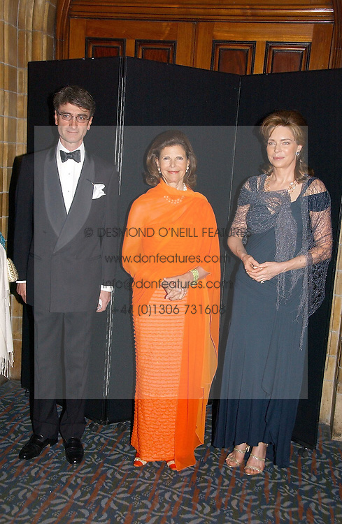 Left to right, LORD MANCROFT, HM QUEEN SILVIA OF SWEDEN and HM QUEEN NOOR OF JORDAN at a gala dinner in the presence of HM Quenn Silvia of Sweden and HM Queen Noor of Jordan in aid of the charity Mentor held at the Natural History Museum, Cromwell Road, London on 23rd May 2006.<br />