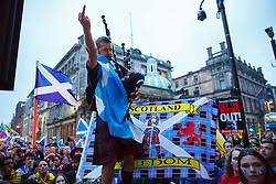 © Licensed to London News Pictures. 18/09/2014. Glasgow, UK. Scottish Independence campaigners posing against a Unionists group after debating at George Square in Glasgow whilst people of Scotland going to polling stations to vote on the Scottish independence referendum on Thursday, 18 September 2014. Photo credit : Tolga Akmen/LNP