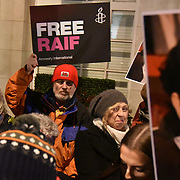 London,UK,22th January 2015 : Amnesty International UK held a vigil for Raif Badawi outside the Saudi Arabian Embassy in London. Raif is being held for life and scheduled to receive weekly public beatings for blogging in Saudi Arabia. Photo by See Li