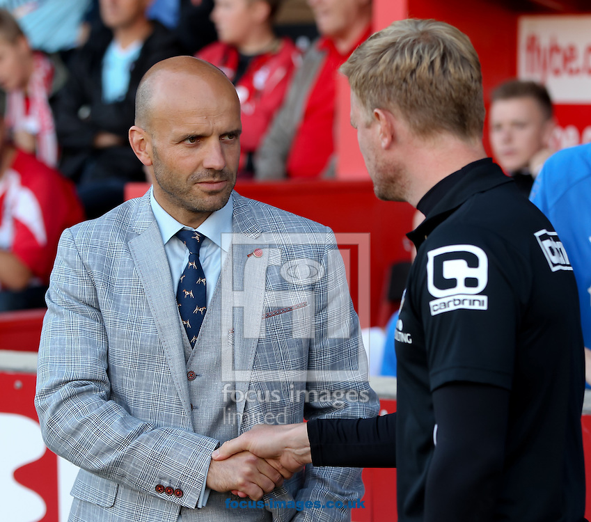 Exeter City manager Paul Tisdale (left) greets AFC Bournemouth Manager Eddie Howe (right) before the Capital One Cup match at St James' Park, Exeter<br /> Picture by Tom Smith/Focus Images Ltd 07545141164<br /> 12/08/2014