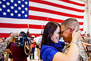 16 JUNE 2010 - PHOENIX, AZ: Candice Hewitt LEFT greets her husband, Spc. Brandon Hewitt at the 161st Air Refueling Wing hangar at Sky Harbor Airport in Phoenix Wednesday. Members of the 3666th Maintenance Company (CQ) of the Arizona Army National Guard returned to Phoenix Wednesday after serving in Iraq (CQ).   PHOTO BY JACK KURTZ