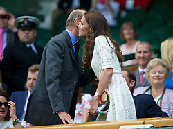 LONDON, ENGLAND - Wednesday, July 2, 2014: Catherine Kate Middleton (Dutchess of Cambridge) kisses Edward Windsor (Duke of Kent) during the Ladies' Singles Quarter-Final match on day nine of the Wimbledon Lawn Tennis Championships at the All England Lawn Tennis and Croquet Club. (Pic by David Rawcliffe/Propaganda)