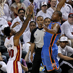Jun 21, 2012; Miami, FL, USA; Oklahoma City Thunder small forward Kevin Durant (35) dunks over Miami Heat power forward Udonis Haslem (40) during the first quarter in game five in the 2012 NBA Finals at the American Airlines Arena. Mandatory Credit: Derick E. Hingle-US PRESSWIRE