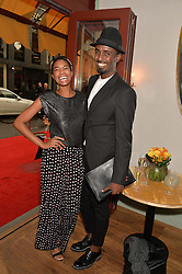 TOLULA ADEYEMI and MASON SMILLIE at the 50th anniversary party for Daphne's restaurant, 112 Draycott Avenue, London held on 24th June 2014.