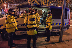 "© Licensed to London News Pictures . 15/12/2017. Manchester, UK. Police detain a man in a van on Sackville Street . Revellers out in Manchester City Centre overnight during "" Mad Friday "" , named for historically being one of the busiest nights of the year for the emergency services in the UK . Photo credit: Joel Goodman/LNP"