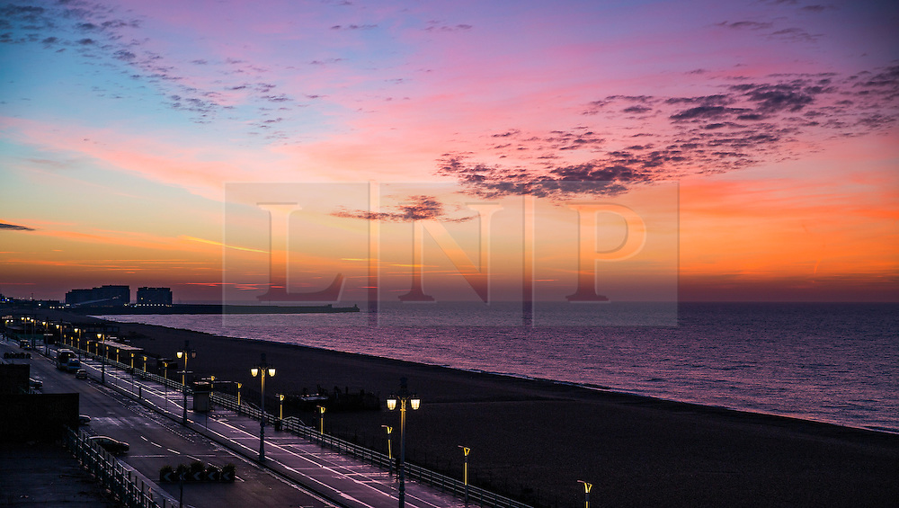 © Licensed to London News Pictures. 14/12/2016. Brighton, UK. A colourful sunrise over Brighton seafront. Photo credit: Hugo Michiels/LNP