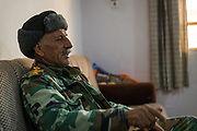 Nineveh Protection Unit (NPU) Colonel Jawed Habeeb Abosh drinks tea in his office in the Christian town of Qaraqosh on December 13, 2016. <br /> <br /> The NPU, a Christian militia, now under the authority of the Iraqi Ministry of Defence, is present in Qaraqosh and other Iraqi Christian towns in an effort to protect them following the liberation from IS control in October 2016.<br /> <br /> Colonel Abosh speaks about the future of Christians and Muslims and the potential for people from both religions to co-exist peacefully again. He says: &quot;With one hand I will hold my weapon, with the other hand I will say 'welcome'. So if something bad happens again we will be ready to fight.&quot;