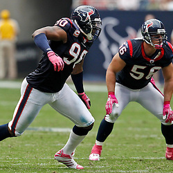 October 10, 2010; Houston, TX USA; Houston Texans defensive end Mario Williams (90) and linebacker Brian Cushing (56) against the New York Giants during the first half at Reliant Stadium. Mandatory Credit: Derick E. Hingle