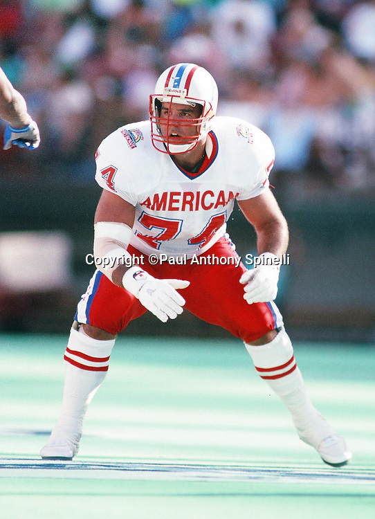 Houston Oilers offensive lineman Bruce Matthews (74) makes a move during the 1990 NFL Pro Bowl between the National Football Conference and the American Football Conference on Feb. 4, 1990 in Honolulu. The NFC won the game 27-21. (©Paul Anthony Spinelli)