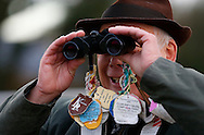 Plumpton, UK, 16th January 2017<br /> A punter watches the racing though a pair of binoculars at Plumpton Racecourse.<br /> &copy; Telephoto Images / Alamy Live News