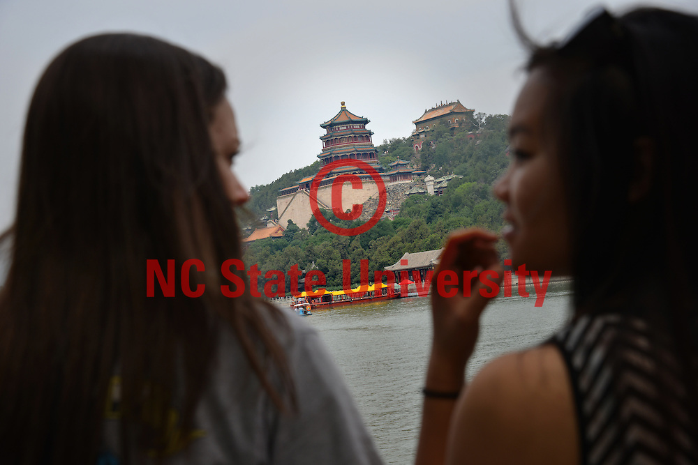 Poole College of Management Study Abroad students talk about Tower of Buddhist Incense on the other side of the Kunming Lake.