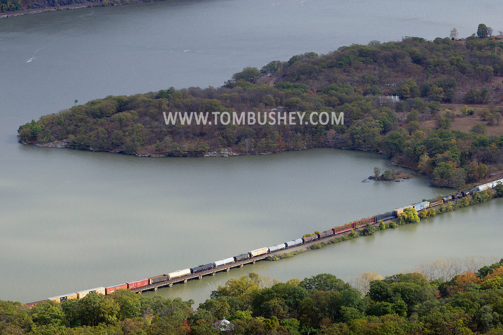 Bear Mountain, New York - A freight train heads north on the railroad track on the western shore of the Hudson River in a view from the top of Bear Mountain at Bear Mountain State Park on Oct. 24, 2014.