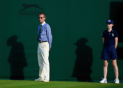 LONDON, ENGLAND - Monday, June 23, 2008: A Wimbledon line judge and ball-girl during day one of the Wimbledon Lawn Tennis Championships at the All England Lawn Tennis and Croquet Club. (Photo by David Rawcliffe/Propaganda)