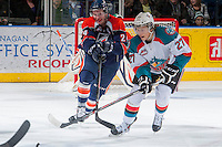 KELOWNA, CANADA - DECEMBER 27: Ryan Rehill D #24 of the Kamloops Blazers checks Ryan Olsen #27 of the Kelowna Rockets on December 27, 2013 at Prospera Place in Kelowna, British Columbia, Canada.   (Photo by Marissa Baecker/Shoot the Breeze)  ***  Local Caption  ***