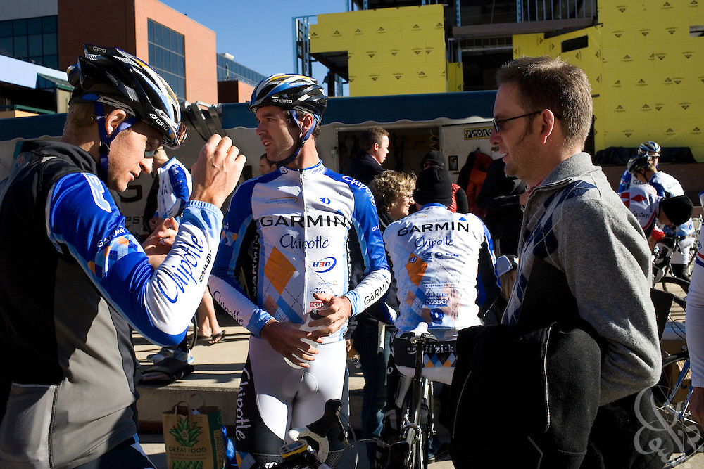 Team Garmin-Chipotle road racer David Millar (c) talks with fellow team riders and general manager Jonathan Vaughters (r) prior a team ride November 22, 2008 in Boulder, Colorado.  The Garmin-Chipotle team are at the forefront of a new effort within the professional cycling world to establish strict new anti-drug standards.  The team not only tests its riders for drugs, but has established biological profiles of team members that can be monitored for changes that would indicate the use of illegal performance enhancing drugs or blood doping techniques.