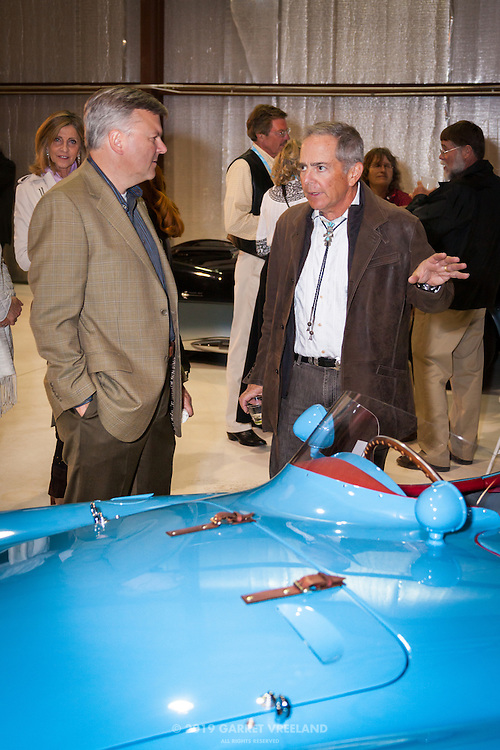 Car Owner and attendee discuss Ferrari, Planes and Cars at the Santa Fe Airport, 2013 Santa Fe Concorso.