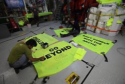ATLANTIC OCEAN ABOARD ARCTIC SUNRISE 11MAY11 - Greenpeace volunteers paint campaign banners aboard the Arctic Sunrise......Photo by Jiri Rezac / Greenpeace