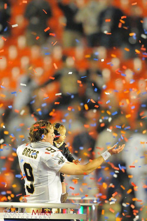 Miami, FL, USA; New Orleans Saints quarterback Drew Brees and his son Baylen Robert Brees celebrate after the Saints beat the Indianapolis Colts 31-17 in Super Bowl XLIV at Sun Life Stadium on Feb 7, 2010...©2010 Scott A. Miller