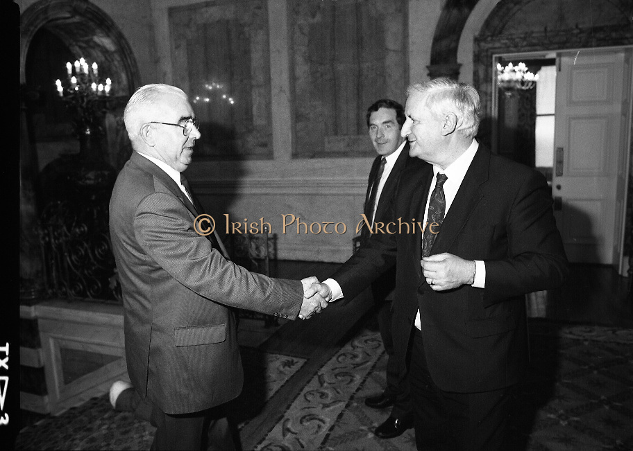 Mayo Football Team At Dept of Foreign Affairs  (T6)..1989..18.09.1989..09.18.1989..18th September 1989..Prior to their return to Mayo, the beaten All ireland Finalists paid a courtesy call on the Dept of Foreign Affairs in Iveagh House, Dublin. Mayo had been beaten by Cork in a thrilling All Ireland Final yesterday afternoon in Croke Park...Image shows department officials greeting a member of the Mayo management team.