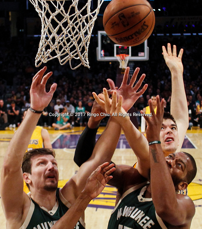 Milwaukee Bucks and Los Angeles Lakers battle for a rebound during an NBA basketball game, Friday, March 17, 2017.(Photo by Ringo Chiu/PHOTOFORMULA.com)<br /> <br /> Usage Notes: This content is intended for editorial use only. For other uses, additional clearances may be required.