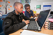 Fifth-graders work on math problems at Frost Elementary School, October 4, 2013.