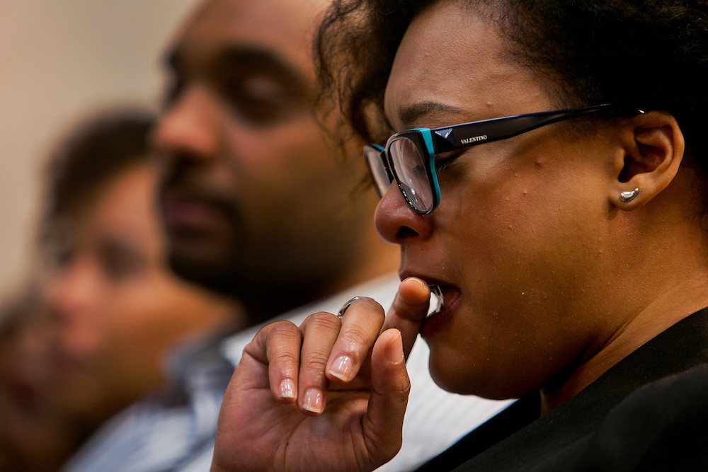 BROOKLYN, NY - JUNE 29, 2016: Widow Trenelle Gabay weeps as District Attorney Ken Thompson speaks at a press conference about the shooting death of Carey Gabay held at the Brooklyn District Attorney's headquarters in Brooklyn, New York. CREDIT: Sam Hodgson for The New York Times.