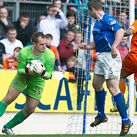 St Johnstone v Dundee Utd....21.04.12   SPL<br /> Alan Mannus collects a back pass header from Frazer Wright<br /> Picture by Graeme Hart.<br /> Copyright Perthshire Picture Agency<br /> Tel: 01738 623350  Mobile: 07990 594431