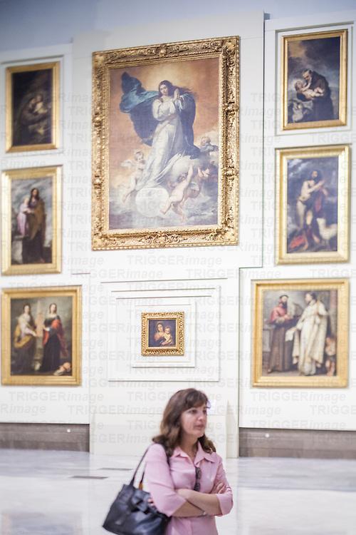 Visitor in the room V (Sevillian Baroque), Museum of Fine Arts, Seville, Spain
