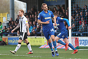 AFC Wimbledon striker James Hanson (18) celebrating after scoring goal during the EFL Sky Bet League 1 match between AFC Wimbledon and Gillingham at the Cherry Red Records Stadium, Kingston, England on 23 March 2019.