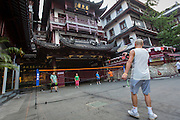 Chinese people play badminton in the Yu Gardens bazaar Shanghai, China