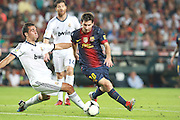 Alvaro Arbeloa of Real Madrid pulls a funny face as Lionel Messi attacks for Barcelona.  Barcelona v Real Madrid, Supercopa first leg, Camp Nou, Barcelona, 23rd August 2012...Credit - Eoin Mundow/Cleva Media.