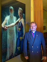 "22 May, 2018. Edinburgh, Scotland, UK. Video installation ""Three Women"" by Bill Viola at St. Cuthbert's Parish Church in Edinburgh. The Minister of St. Cuthbert's, the Rev Peter Sutton, admires the work of Bill Viola which is on loan to the church until September. Although on display since 1 May, the display has not been publicised until this week."