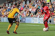 York City defender David Tutonga on loan from Cardiff City takes on Newport County defender Danny Holmes during the Sky Bet League 2 match between Newport County and York City at Rodney Parade, Newport, Wales on 5 September 2015. Photo by Simon Davies.