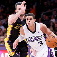 28 February 2014: Sacramento Kings point guard Ray McCallum (3) drives past Los Angeles Lakers point guard Jordan Farmar (1) during the Los Angeles Lakers 126-122 victory over the Sacramento Kings at the Staples Center, Los Angeles, California, USA.