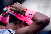MELBOURNE, VIC - JANUARY 17: Rafael Nadal of Spain puts on his head band in his second round match during the 2018 Australian Open on January 17, 2018, at Melbourne Park Tennis Centre in Melbourne, Australia. (Photo by Jason Heidrich/Icon Sportswire)MELBOURNE, VIC - JANUARY 17: