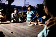 Islamabad: Young boys play a traditional board game under one of the colony's flood lights..Pakistan's Christian communities account for an estimated one percent of the country's 180 million population...I the middle of Islamabad's wealthiest neighbourhood is a 'colony' that's home to some 4000 Christians. Narrow alleys separate multi-storey, squalid houses with open sewers running meandering the alleys to the river that runs through the heart of the colony...Some are recent arrivals from Faisalabad and Gojra, where recent sectarian killings forced many to relocate to the relative safety of the capitol territory. Many are second and third generation residents squatting on land that sees no development assistance from the Capital Development Authority. Power outages are frequent, many residents sleep on the roofs during the long summer months, there are no air-conditioners in the colony...Many of the residents are unemployed; those fortunate to have any income usually work as servants, gardeners, drivers, security guards or cleaners. ..Discrimination against the Christian minorities is rampant in Pakistani society. Many suspect the government of deliberately keeping them at the bottom of the economic ladder to appease the radical religious parties...©JTanner/August2011