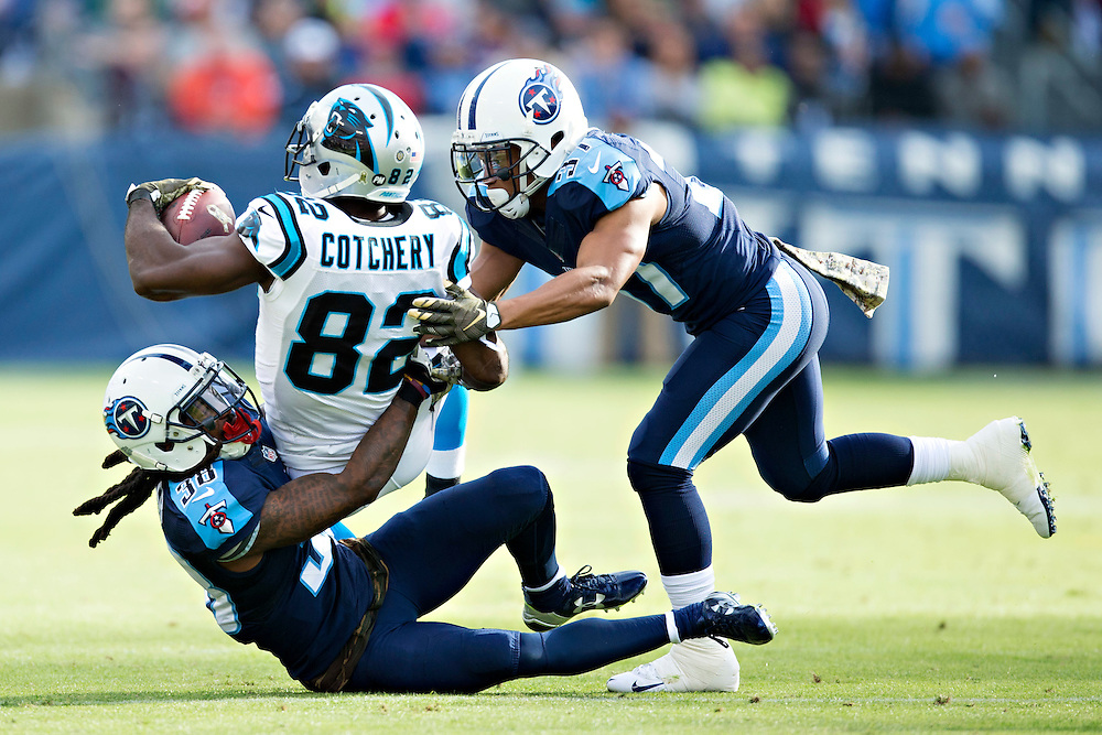 NASHVILLE, TN - NOVEMBER 15:  Cody Riggs #37 and B.W. Webb #38 of the Tennessee Titans tackle Jerricho Cotchery #82 of the Carolina Panthers at Nissan Stadium on November 15, 2015 in Nashville, Tennessee.  (Photo by Wesley Hitt/Getty Images) *** Local Caption *** Cody Riggs; B.W. Webb; Jerricho Cotchery