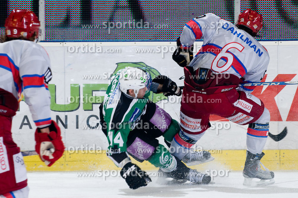 Toni Dahlman (HK Acroni Jesenice, #6) vs Matej Hocevar (HDD Tilia Olimpija, #14) during ice-hockey match between HDD Tilia Olimpija and HK Acroni Jesenice in 41st Round of EBEL league, on Januar 23, 2011 at Hala Tivoli, Ljubljana, Slovenia. (Photo By Matic Klansek Velej / Sportida.com)
