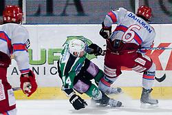 Toni Dahlman (HK Acroni Jesenice, #6) vs Matej Hocevar (HDD Tilia Olimpija, #14) during ice-hockey match between HDD Tilia Olimpija and HK Acroni Jesenice in 41st Round of EBEL league, on Januar 23, 2011 at Hala Tivoli, Ljubljana, Slovenia. (Photo By Matic Klansek Velej / Sportida.com)