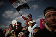 EGYPT, Cairo :  Egyptian stand in Tahrir Square, in Cairo on Friday 27, Jan.2012..