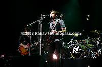 Kings of Leon performing at Madison Square Garden on January 29, 2009. .l-r .Matthew Followill - wearing black leather jacket (lead guitar/backup vocals)..Caleb Followill -  beard, wearing a grey t-shirt and black vest. (lead singer/rhythm guitar. Nathan Followill (drums/backup vocals)..