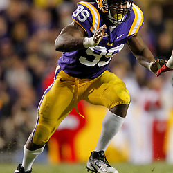 November 12, 2011; Baton Rouge, LA, USA;  LSU Tigers defensive end Sam Montgomery (99) against the Western Kentucky Hilltoppers during the second half of a game at Tiger Stadium. LSU defeated Western Kentucky 42-9. Mandatory Credit: Derick E. Hingle-US PRESSWIRE