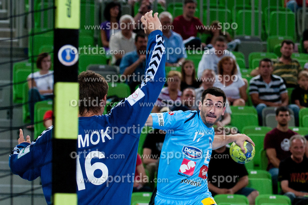 Dragan Gajic of Slovenia vs Gennadiy Komok of Ukraine during handball match between National teams of Slovenia and Ukraine of 2012 EHF Men's European Championship Play-off, on June 12, 2011 in Arena Stozice, Ljubljana, Slovenia. (Photo By Matic Klansek Velej / Sportida.com)