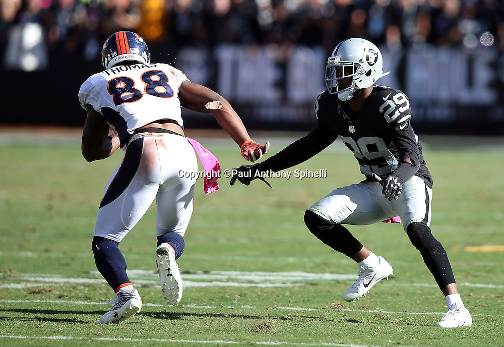 Oakland Raiders cornerback David Amerson (29) plays tight pass coverage on Denver Broncos wide receiver Demaryius Thomas (88) during the 2015 NFL week 5 regular season football game against the Denver Broncos on Sunday, Oct. 11, 2015 in Oakland, Calif. The Broncos won the game 16-10. (©Paul Anthony Spinelli)