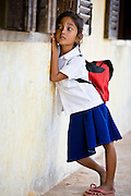 15 MARCH 2006 - CHONG KOH, KANDAL, CAMBODIA: A girl looks into her classroom at the elementary school in Chong Koh, a village on the Mekong River in central Cambodia. Photo by Jack Kurtz