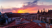 Sunset over the ancient rooftops of the old town of Coimbra, Portugal