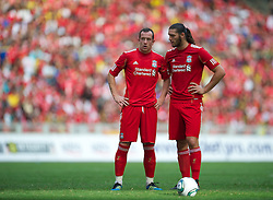 KUALA LUMPUR, MALAYSIA - Saturday, July 16, 2011: Liverpool's new signing Charlie Adam and Andy Carroll in action against a Malaysia XI at the National Stadium Bukit Jalil in Kuala Lumpur on day six of the club's Asia Tour. (Photo by David Rawcliffe/Propaganda)